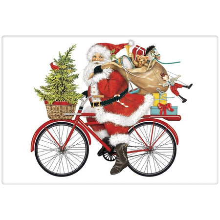 White towel. Santa riding a bike with gifts on the back, a bag of presents over his shoulder and a tree in the front basket.