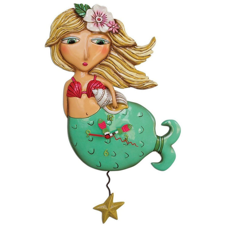 Mermaid design clock. Mermaid is blonde with a pink shell bra, a conch shell in hand & a green tail. Pendulum is a starfish.