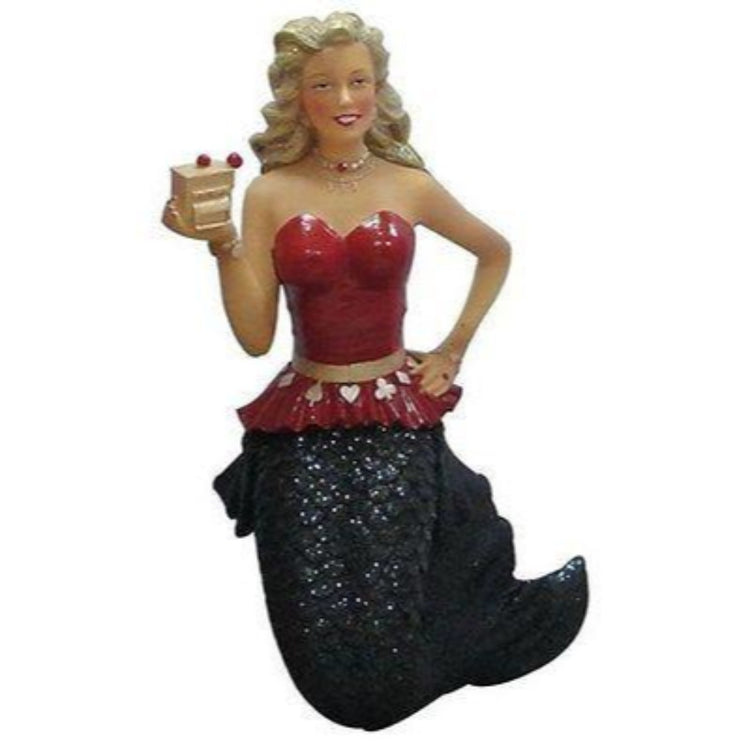 Mermaid shaped figurine hanging ornament.  Wearing black tail, red top with belt with card suits on them holding a slot machine.