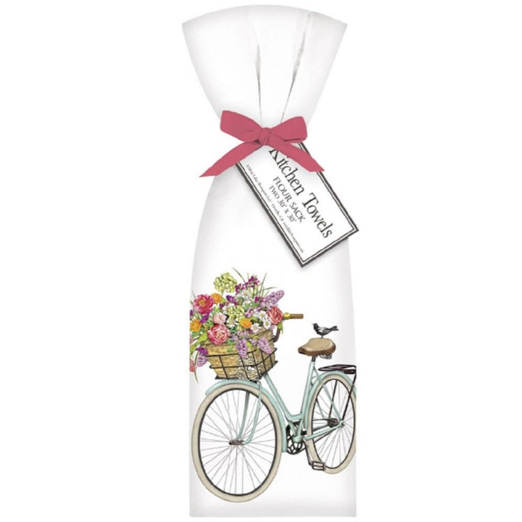 2 white towels tied with pink ribbon. Towel shows a light blue bike with basket of pink, purple & orange spring flowers.