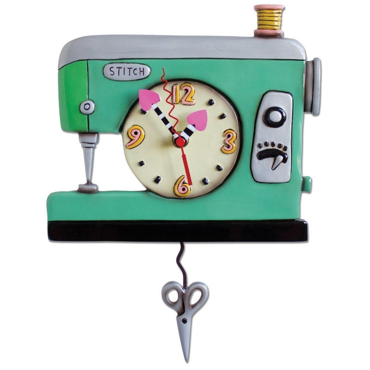 Green sewing machine design wall clock with scissor  pendulum.