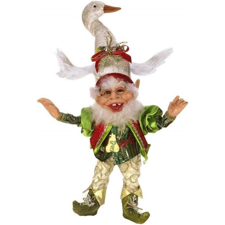 Elf figurine wearing gold and green with a swan hat.
