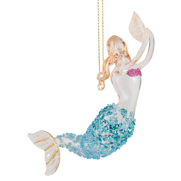Glass mermaid swimming up while holding a shell out in front.  Hair is gold with tail teal and gold. Hanger attached to back