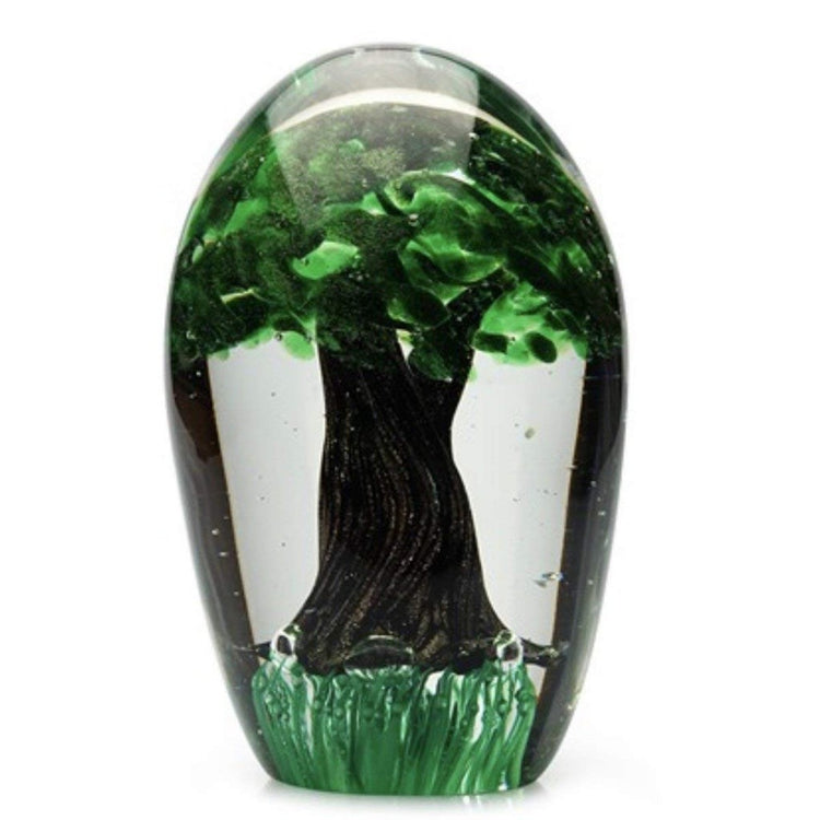 Clear glass paperweight with tree decor encased within.