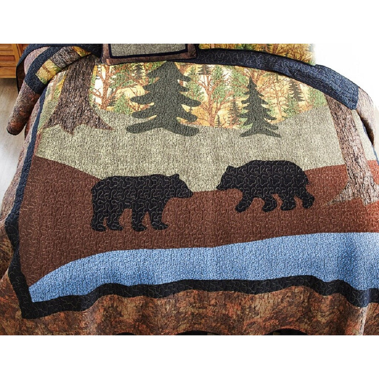 Quilt with wilderness scene and 2 black bears.
