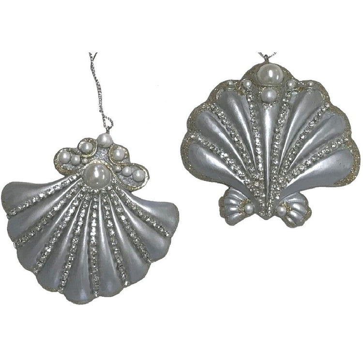Silver shell ornament with pearl and rhinestone embellishments.
