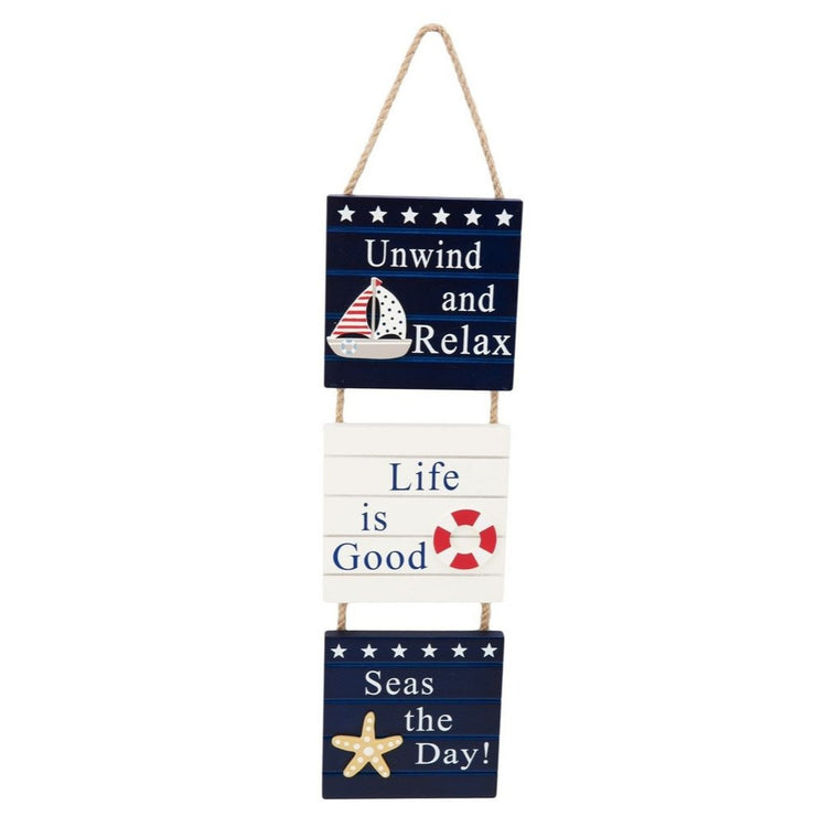 3 square blue & white wooden signs with a rope hanger. 1 says relax & unwind, 1 says life is good, 1 says seas the day.