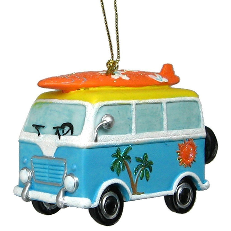 Van shaped Christmas ornament with gold cord.  Blue van with palm tree and sun on side of van and orange surfboard on roof.