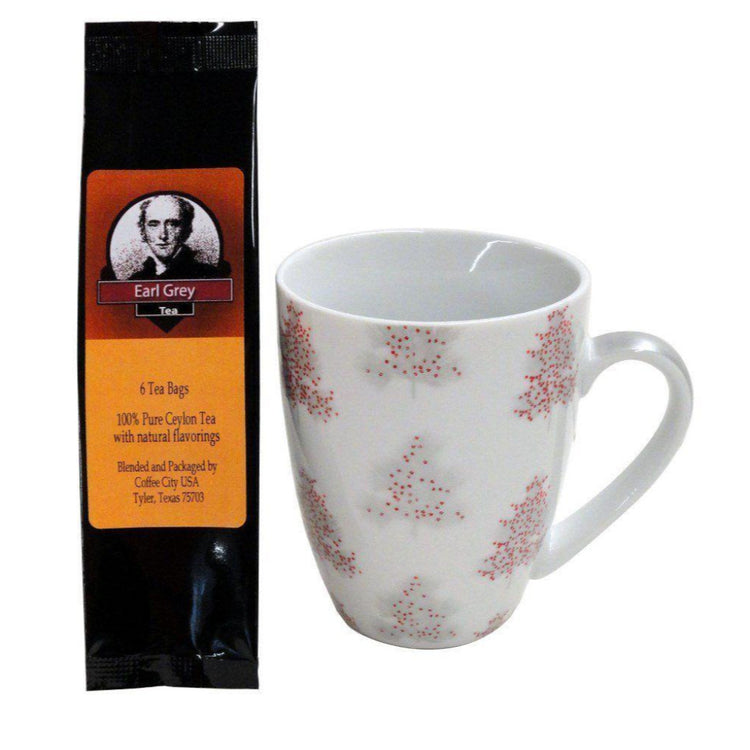 White mug imprinted Christmas trees decorated red. Earl Grey tea package.