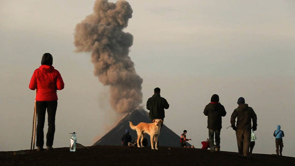 Group watching volcano