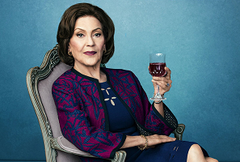 Emily Gilmore sipping a glass of wine