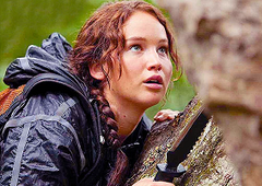 Katniss Everdeen in a tree with a knife in the Hunger Games