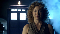 River Song from Dr Who standing in front of the Tardis