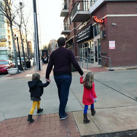 Twin dad Greg Pinn with twin girls walking on street Twinning Store