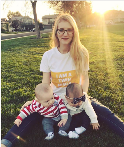 twin mom sitting in grass with her twin babies in twinning store i am a twin mama t-shirt