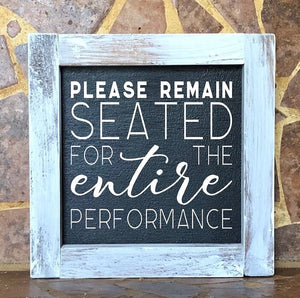 Please Remain Seated For The Entire Performance sign