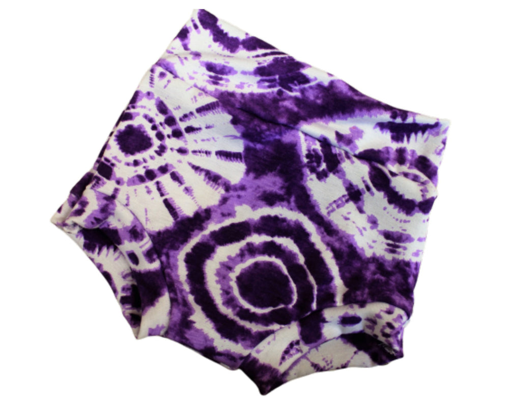 purple tie dye bummies flat lay
