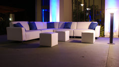 Picture of white lounge sofas with blue accent pillows