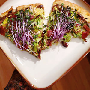 Shredded brussels sprout pizza with garlic, bacon and balsamic