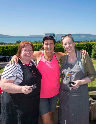 Jewellery Maker Ruth McEwan-Lyon with 2 workshop attendees enjoying the views across Belfast Lough on a sunny day in Northern Ireland