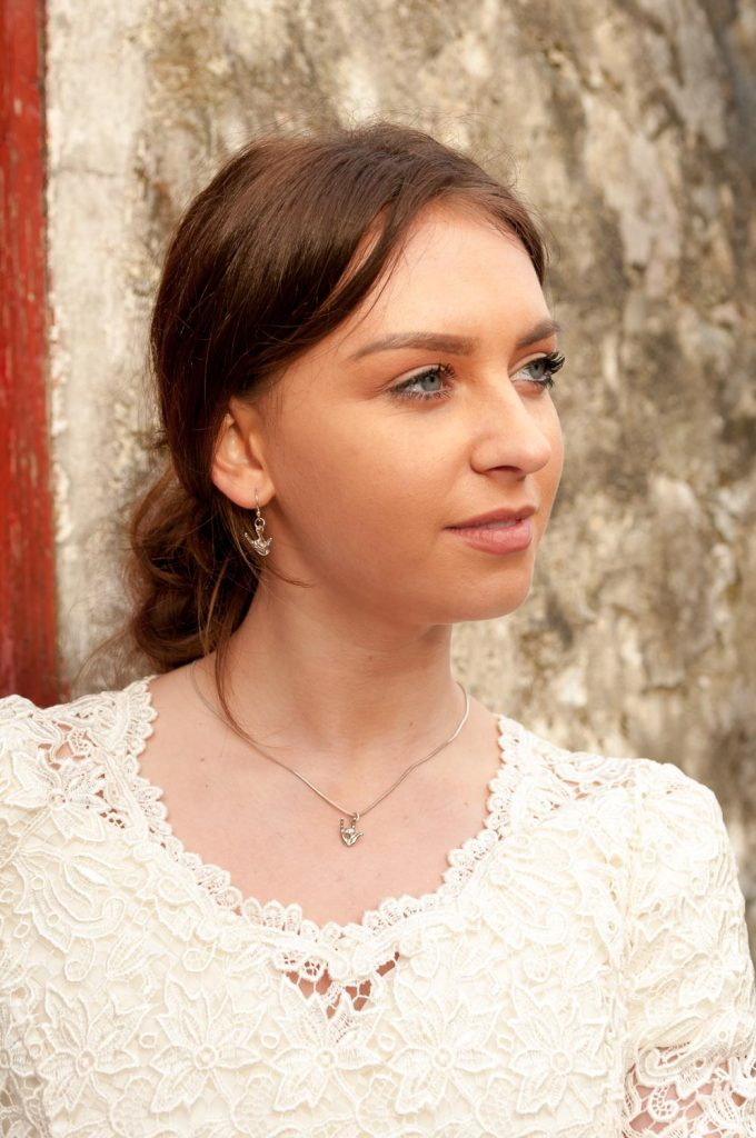 Bride wearing I love you wedding jewellery