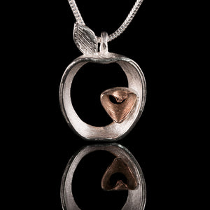 Armagh Apple Silver and Rose Gold necklace on a snake chain.