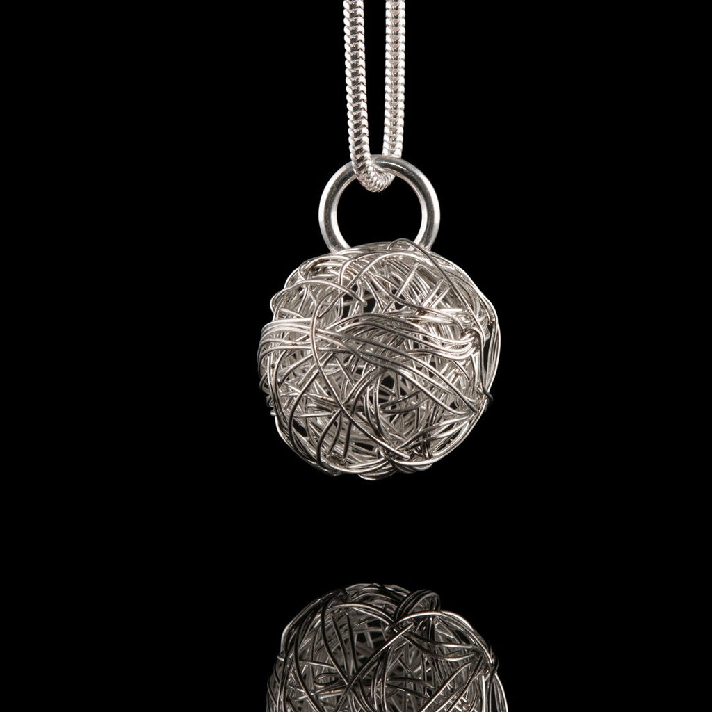 Rise Belfast Necklace, Silver wire wrapped ball on a silver snake chain.