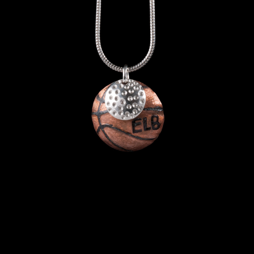 Basketball and Golf ball necklace jewellery commission by Ruth McEwan-Lyon of NI Silver.