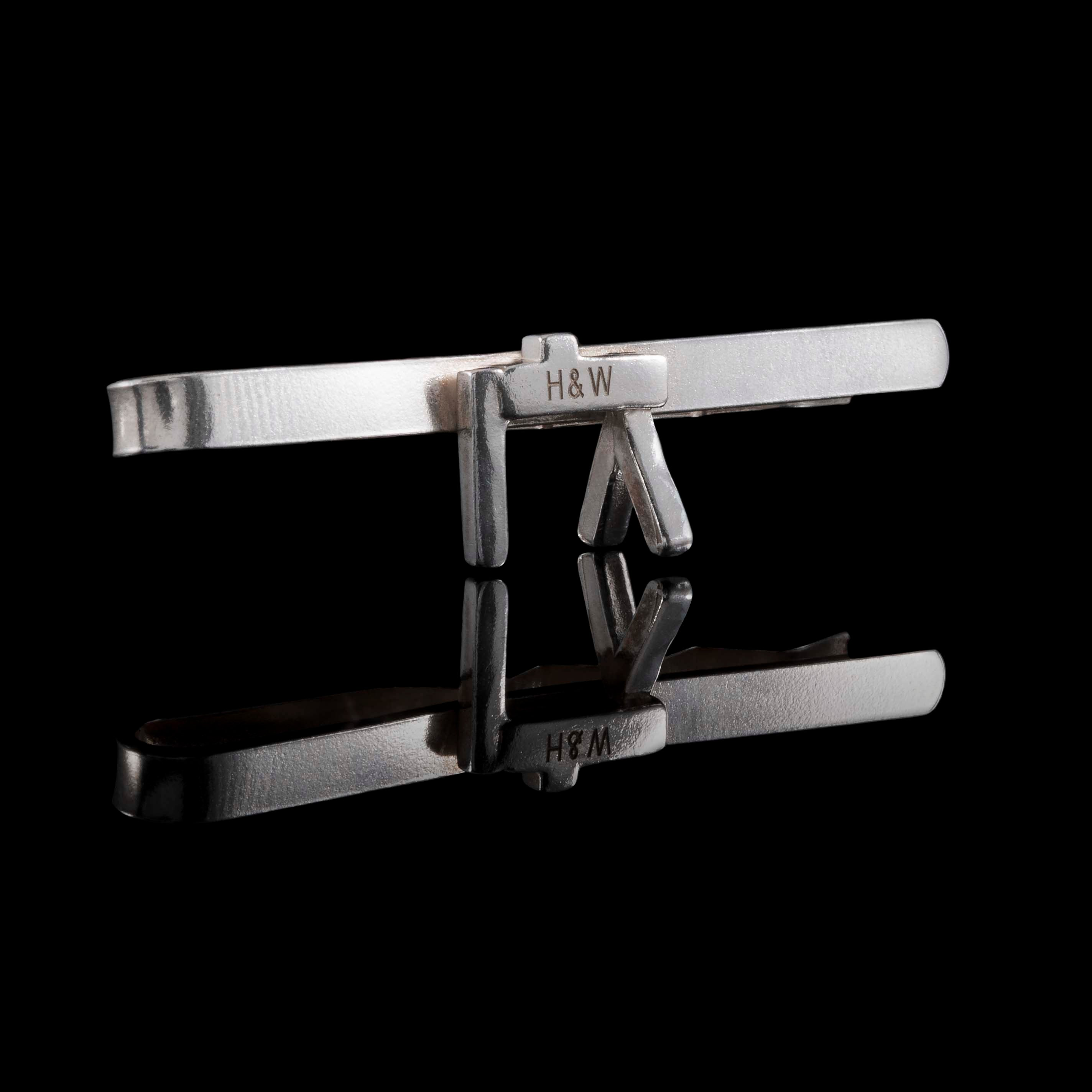Using Sterling Silver and Hallmarking most pieces this collection is of Tie Clips. This photograph shows the Belfast Crane with a Tie Clip bar attached to the uppermost horizontal beam.