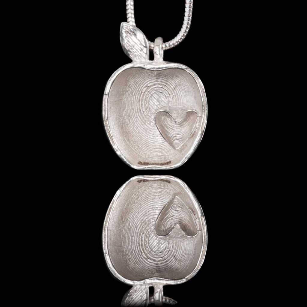 Sterling 925 Silver necklace in the shape of a 'half' Bramley Apple with a small love heart placed inside to celebrate County Armagh as the Orchard of Ireland.