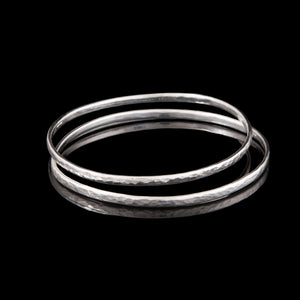 Silver Bangle handmade and hit with a hammer to create a textured pattern.  Sterling Silver made in Holywood Northern Ireland by Northern Irish Jewellery designer Ruth McEwan-Lyon