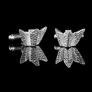 Titanic Belfast Silver Cufflinks. These solid silver cufflinks represent the Belfast Titanic Visitors Centre. This is an amazing building and museum to the RMS Titanic. These cufflinks catch the light and are stunning to wear for any occasion be that a wedding, anniversary or everyday.