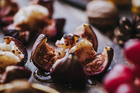 Baked figs with Quicke's goat's cheese