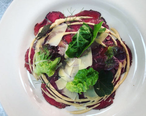 Carpaccio salad with Quicke's Vintage Clothbound Cheddar The Pig