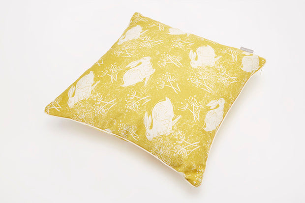 Headlong Hare Yellow Ochre Cotton Piped Cushion