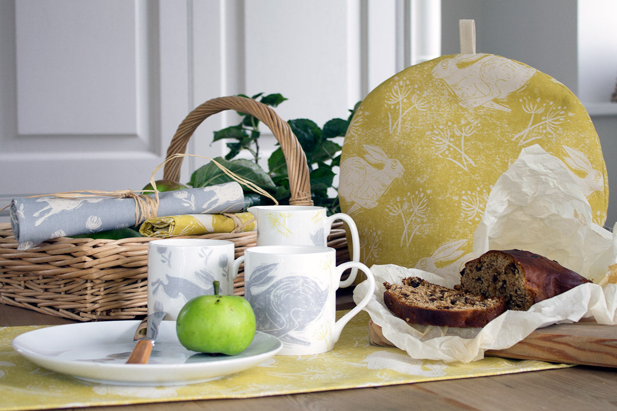 Sam Wilson Headlong Hare Yellow Ochre Cotton Tea Cosy