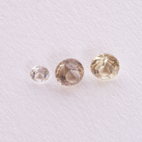4.18ct Australian Quartz Parcel Three Pieces round faceted pale yellow