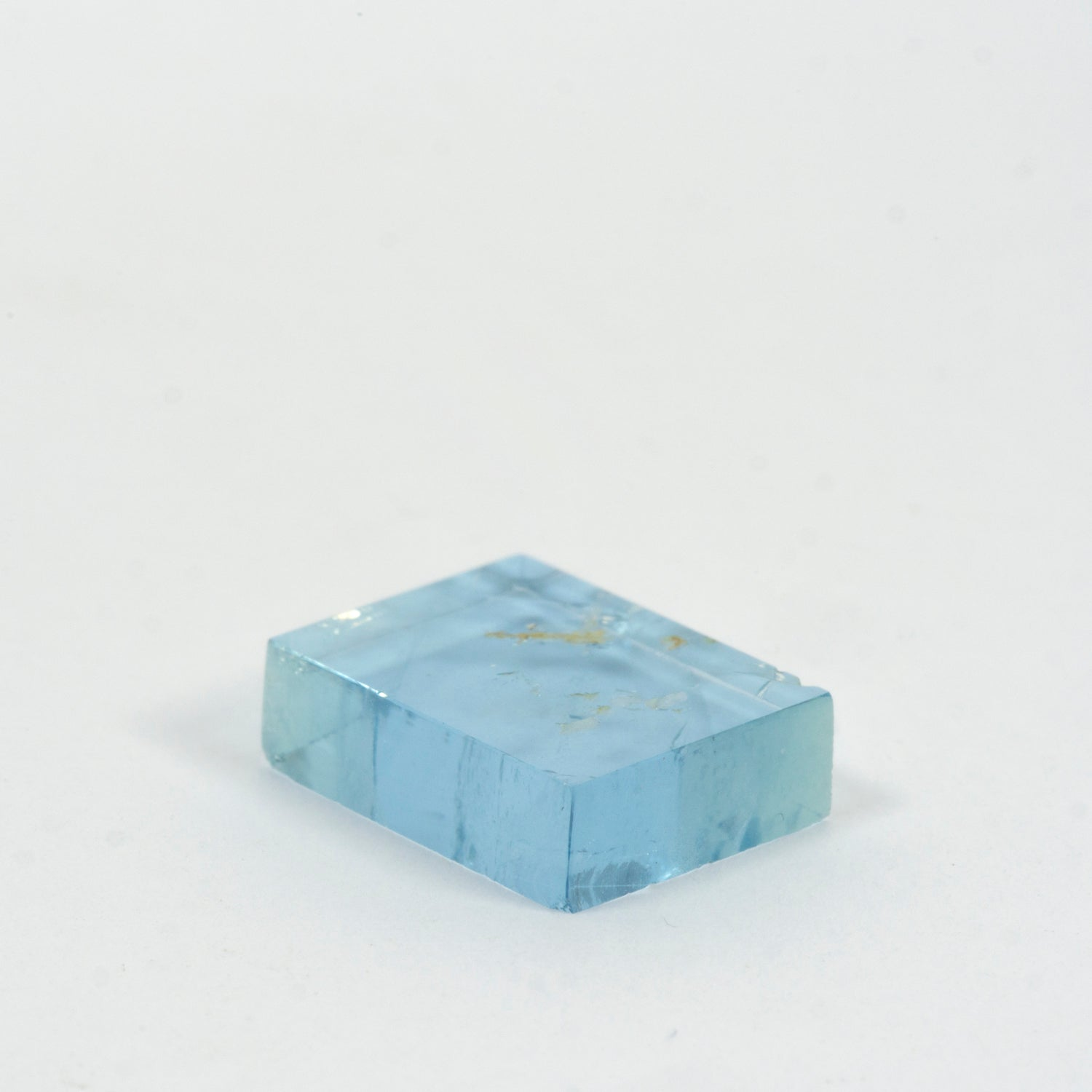 7.74ct Bespoke Rectangular Flat Cut Aquamarine ,5.68ct Bespoke Geo Cut Aquamarine, beautiful aquamarine gemstone in pale sea green, sparkling pale blue beauty, bespoke cutting, responsible sourcing in Mozambique