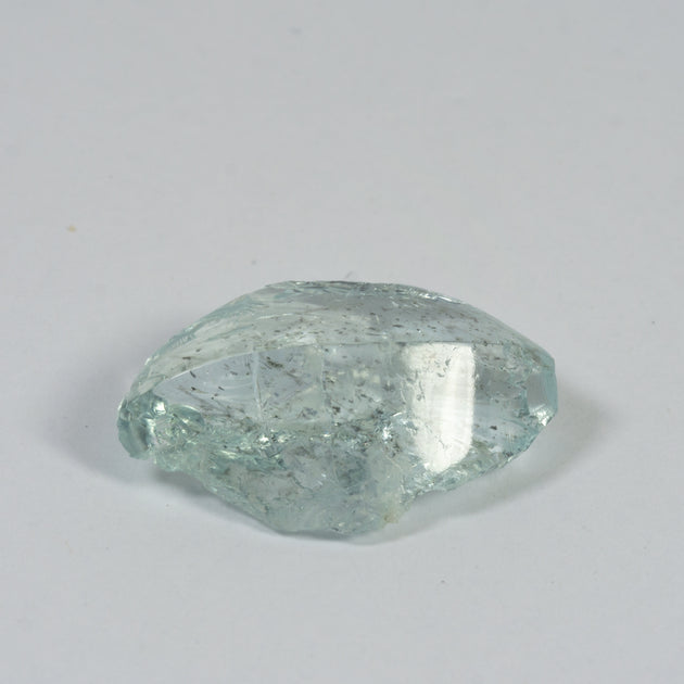 14.69ct Bespoke Rough Cut Aquamarine, modern cut, beautiful aquamarine gemstone in pale sea green, sparkling pale blue beauty, bespoke cutting, responsible sourcing in Mozambique