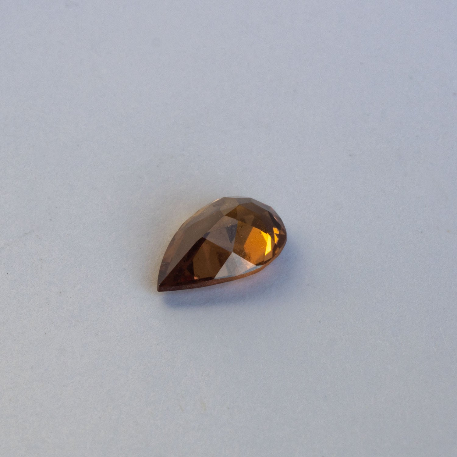 This rich cognac/burnt orange sapphire is has a lovely warm tone is eye clean to most. This piece is unheated and was responsibly sourced from Madagascar.