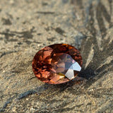 warm but dark toned natural zircon with a hint of peach undertone