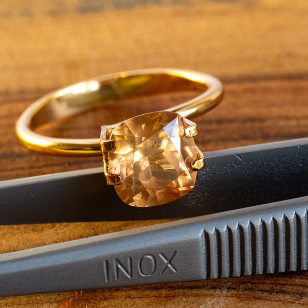 This lovely natural zircon has a sublte light yellow/orange tone and great sparkle from an excellent cut.