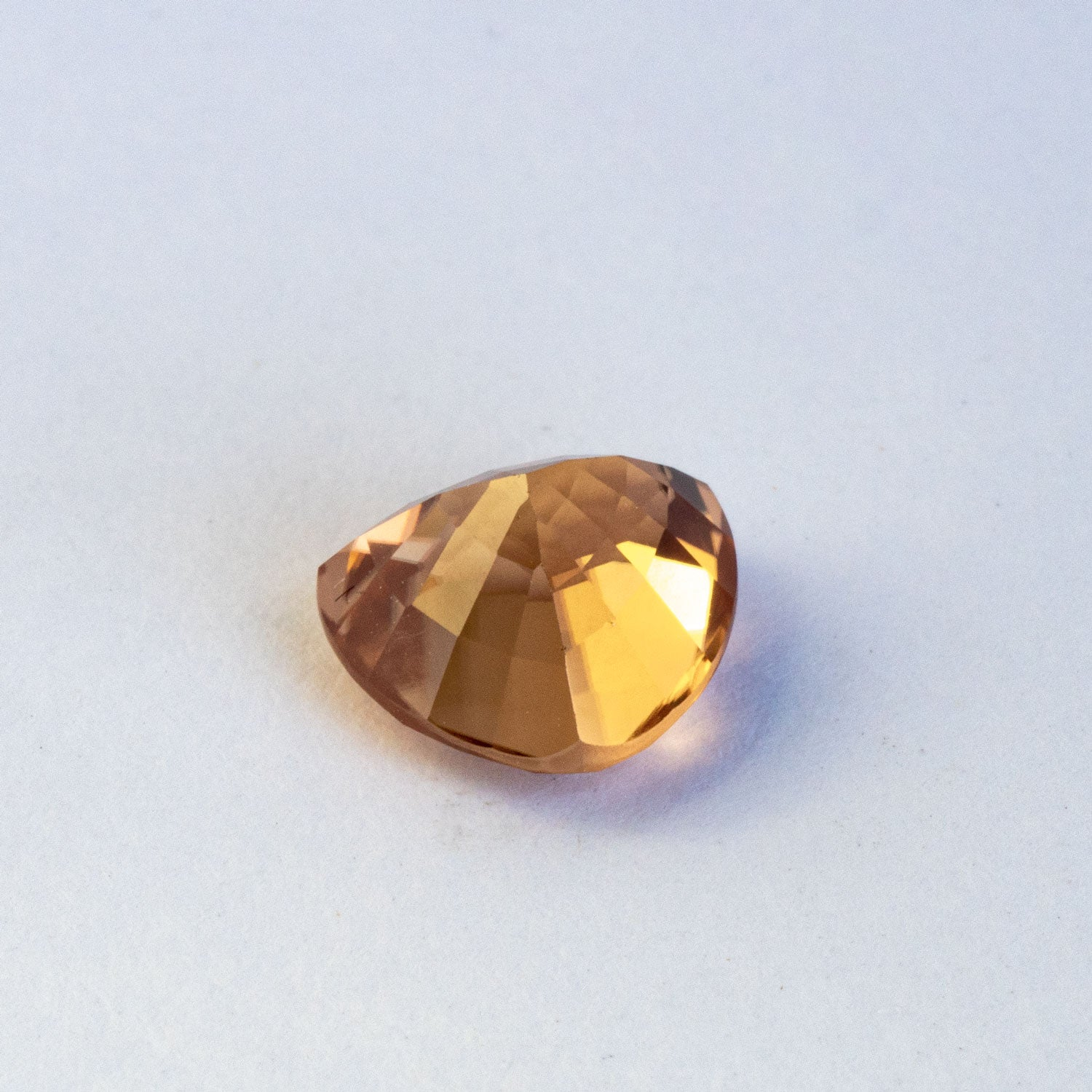 This stunning natural zircon has fantastic sparkle and beautiful golden hue with an ever so slight hint of peach