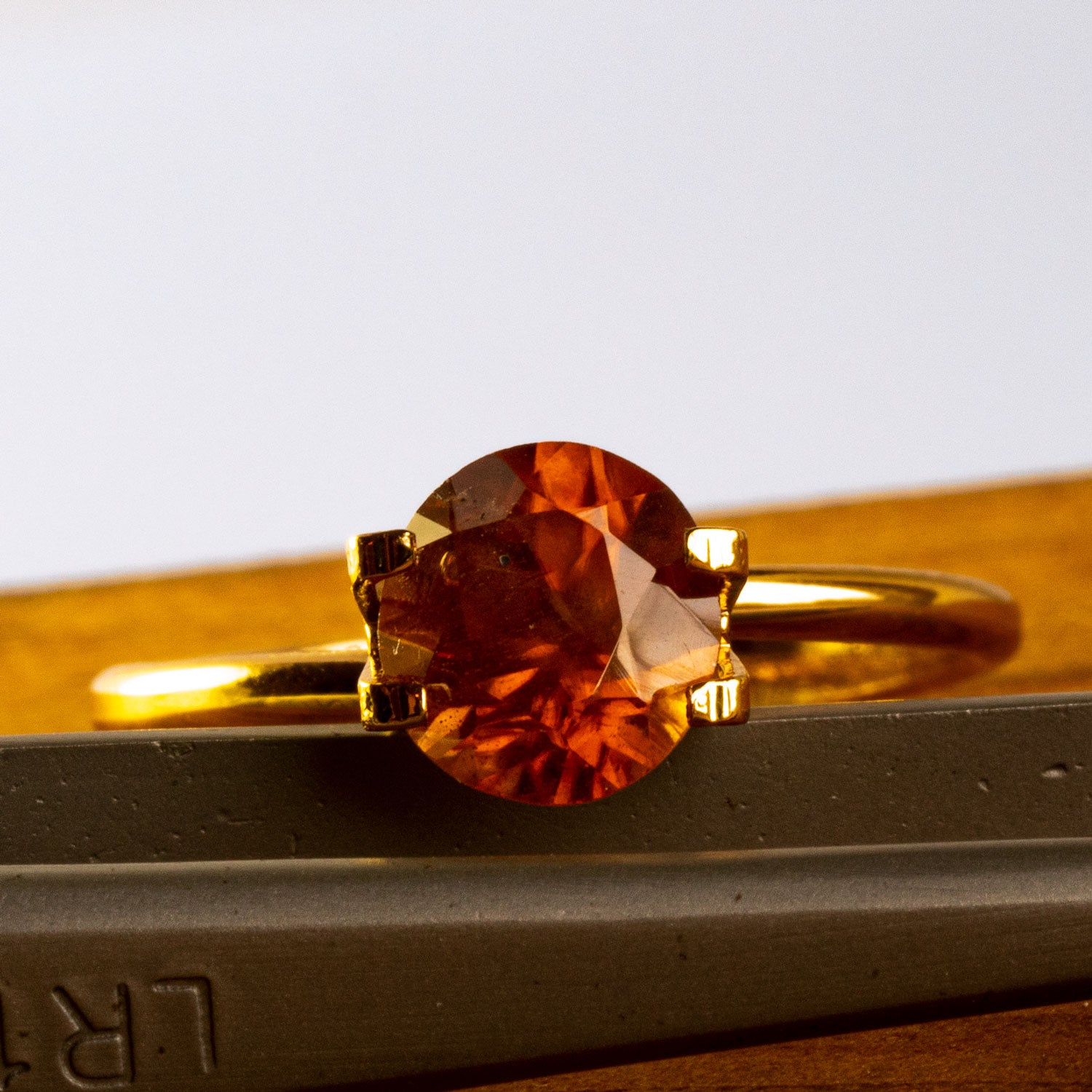 This warm toned natural zircon has a burnt amber feel about its colour