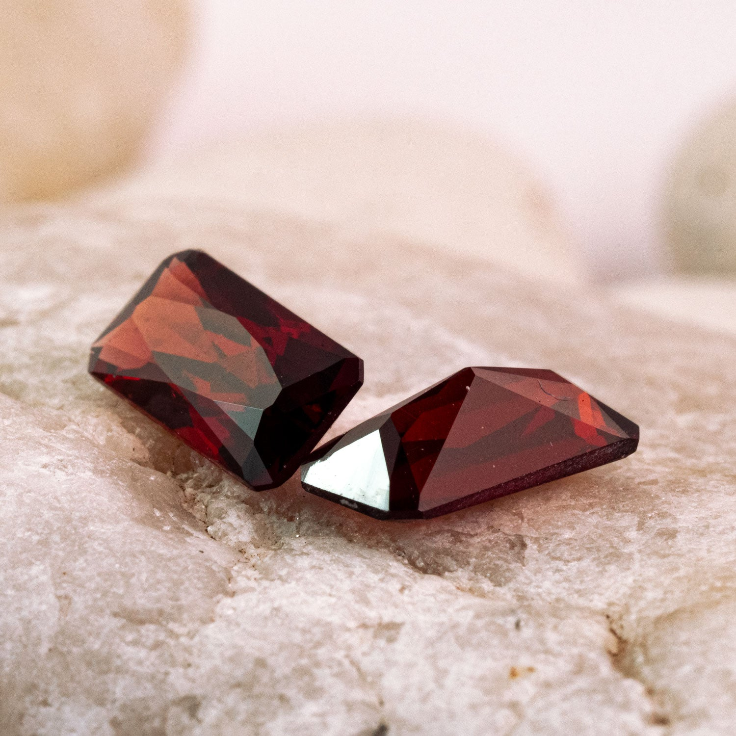 pair of garnets are a deep burgandy with a hint of orange. This pair are unheated and were responsibly sourced as rough gems from Mozambique
