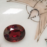 2.41ct Garnet in Oval Cut, deep red faceted oval garnet, January