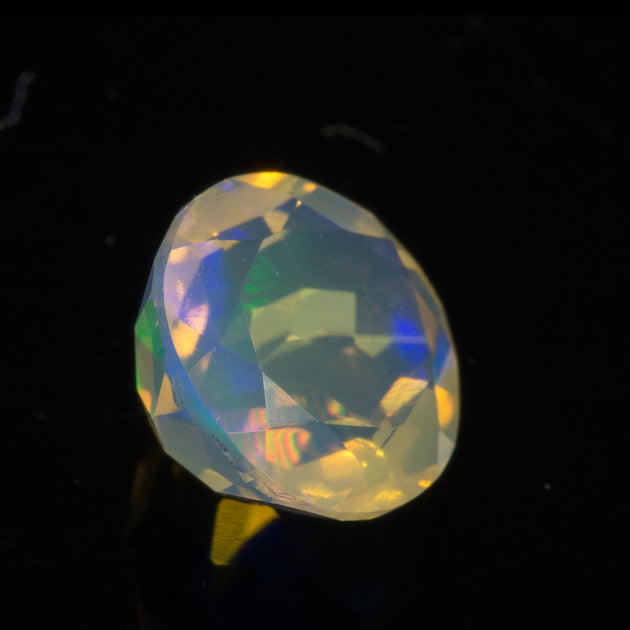 0.94ct Round Cut Faceted Ethiopian Opal