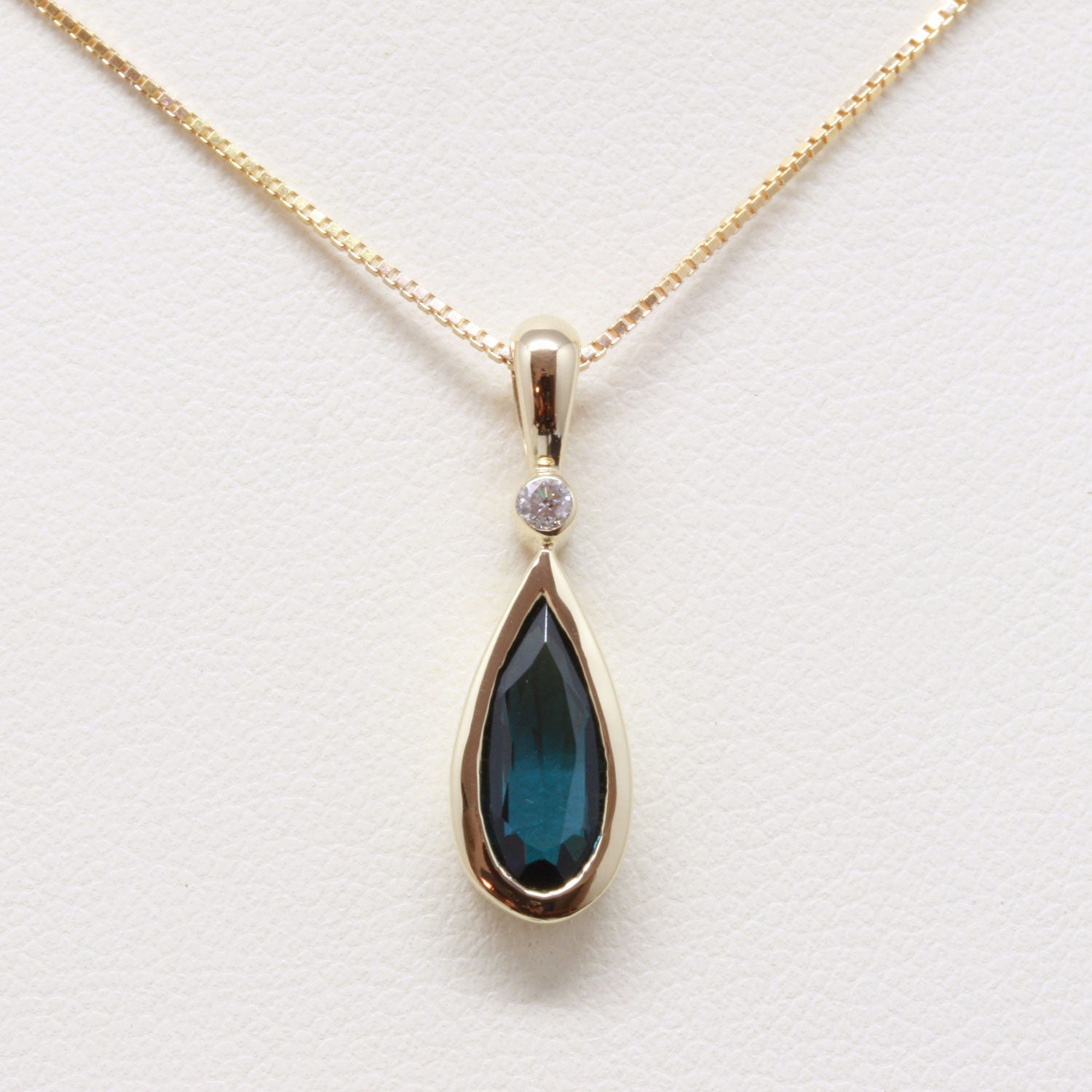 Blue Tourmaline Pear Cut and Diamond Pendant in 10k Gold