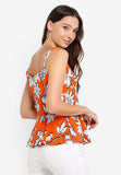 Inez Floral Print Peplum Top in Orange