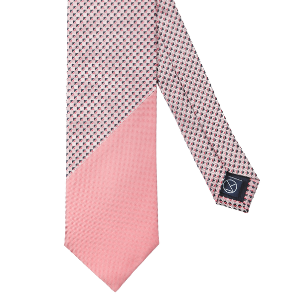 Two-piece tie combining a navy and pink patterned silk with a pale pink diamantino silk.